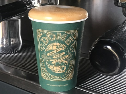 Dome coffee in a takeaway cup