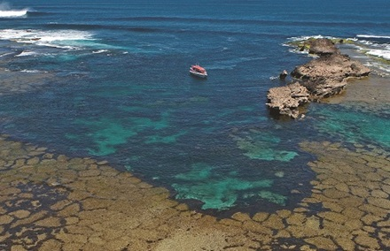 Aerial Catheral Rocks with eco boat